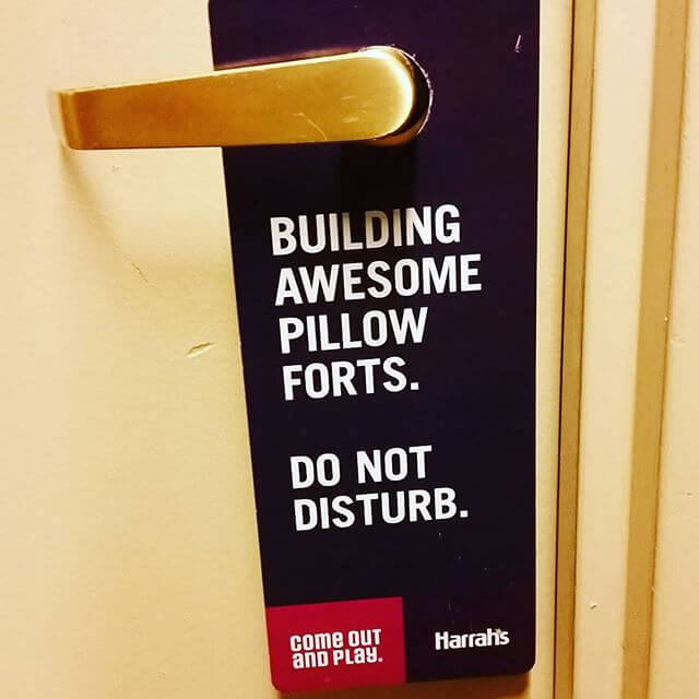 The Funniest Hotel Do Not Disturb Signs You've Ever Seen
