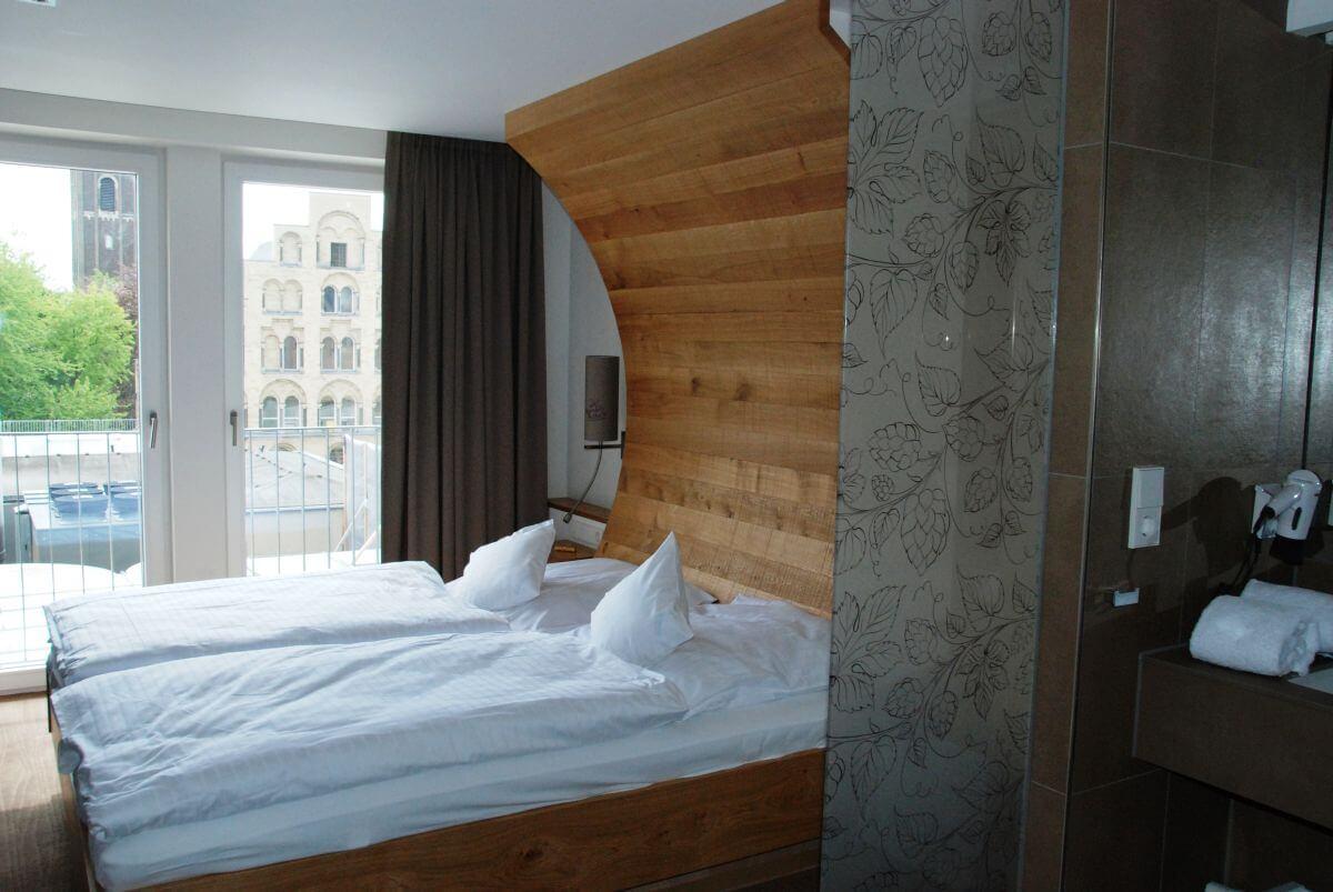 Hotel zur Malzmühle - Betten in Bierfassoptik