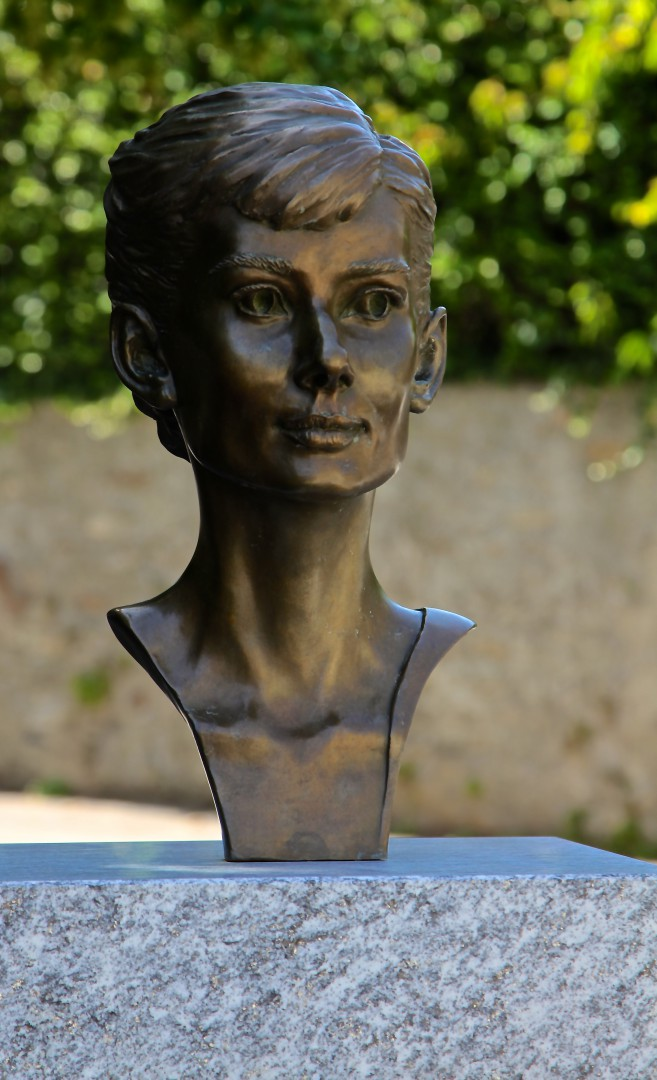 A bust of Audrey Hepburn in the village square of Tocholenaz. Photo by Burce N. Meyer