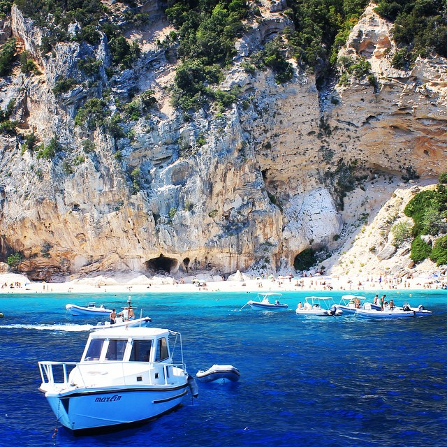 One of Italy's most pristine beaches, Cala Luna is dotted with caves and lush greenery.