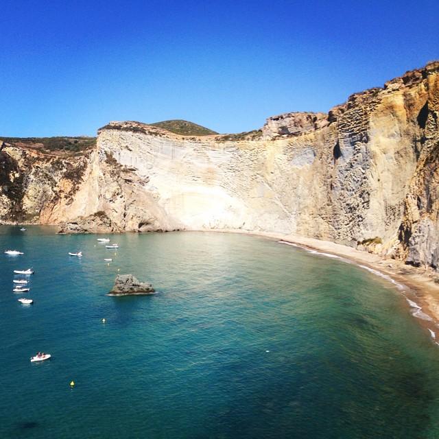 The vertical cliff at Cala Luna Beach provides a dramatic backdrop.