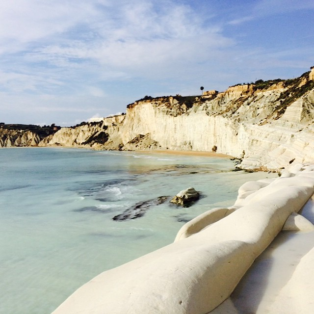 The snow-white cliffs of the Scala de Turchi are perfect for sunbathing on with your plus one.