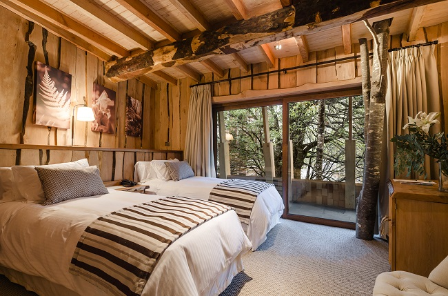 Chambre lits doubles du Reino Fungi Lodge